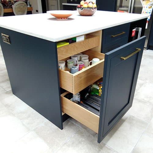 blue black kitchen cabinets with a bespoke oak Tea & Mug Drawer