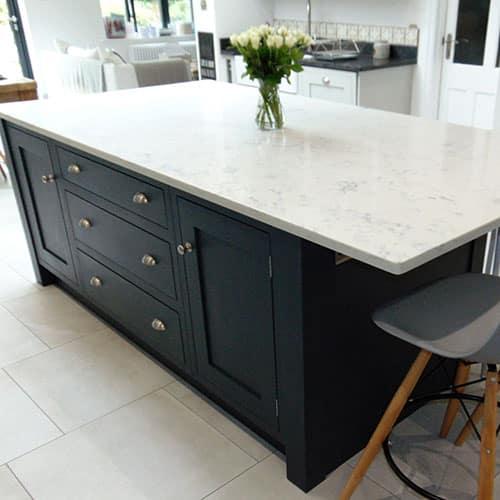 dark grey kitchen island with white marble quartz worktop